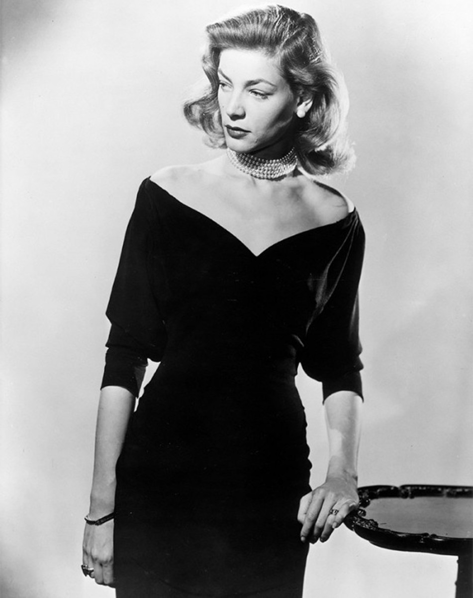 Lauren Bacall wears a pearl choker in the 1940's
