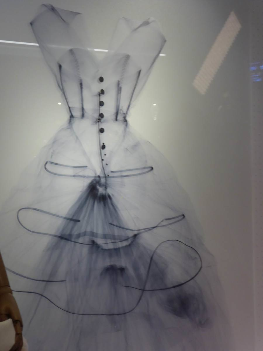 This x-ray of the silk taffeta evening dress is shown next to the garment. It reveals the hoops that maintain the shape and volume of garment. Image by Frances Spiegel with permission from V&A Museum. All rights reserved.