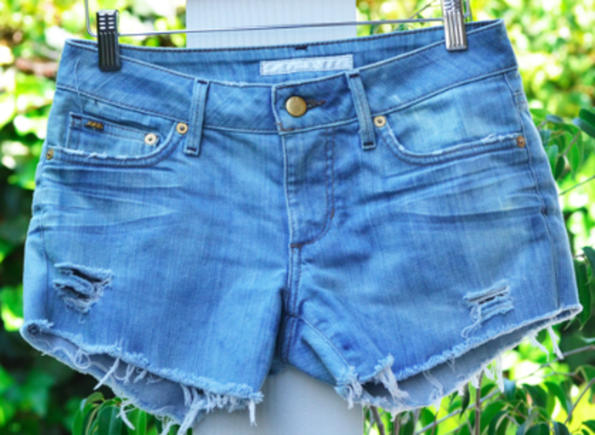 Frayed hems look good too. Just pull some of the cotton threads, then wash the cut off shorts