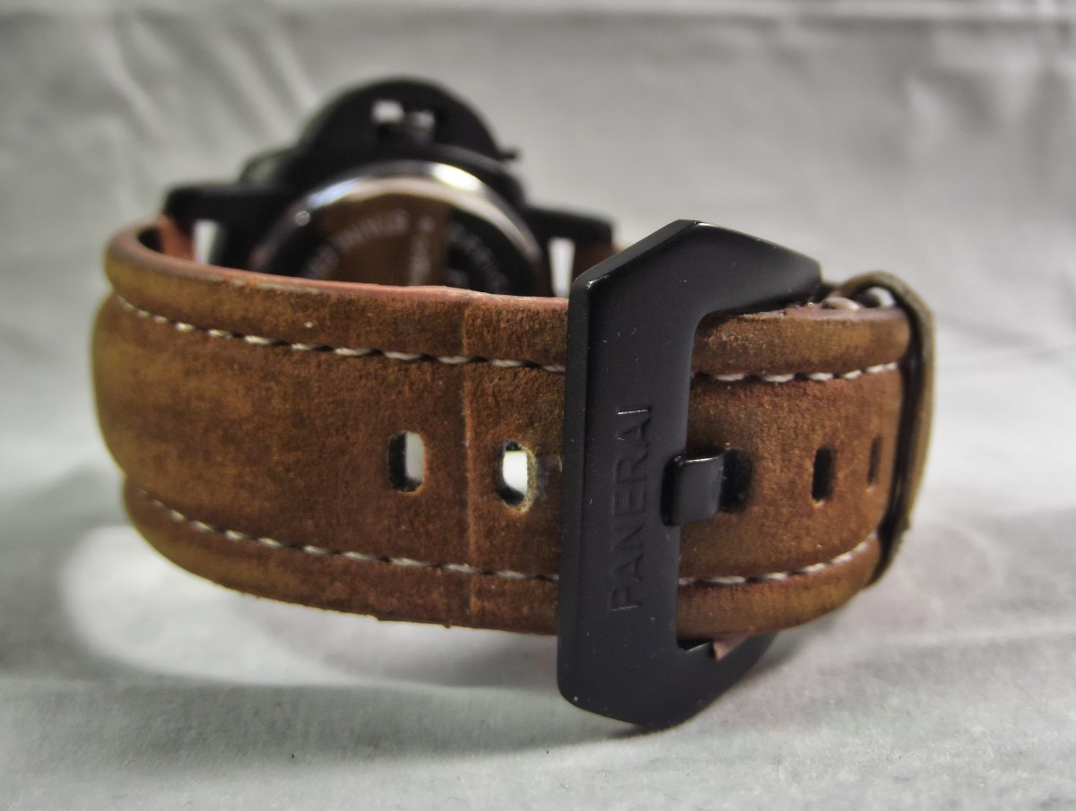Replica Panerai Luminor Marina.  Brown imitation leather coating has began to flake away