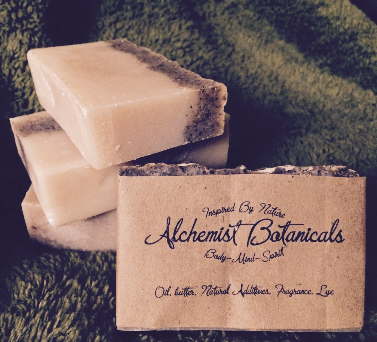 Bay rum and coffee soap that contains bay rum FO, lye, coffee, and coconut oil.