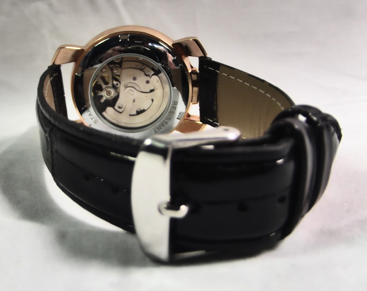 Note that the strap's buckle does not match the color of the Winner U8060 Automatic Watch's case
