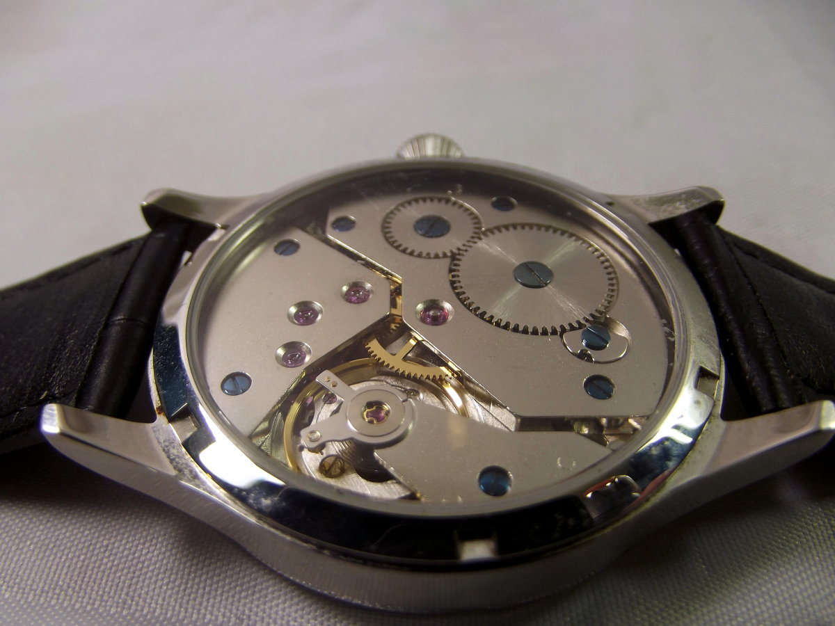 Corgeut 1527 mechanical watch with Asian 6498 movement.  Unlike most movements of this type, there is no adjustment lever attached to the balance wheel.