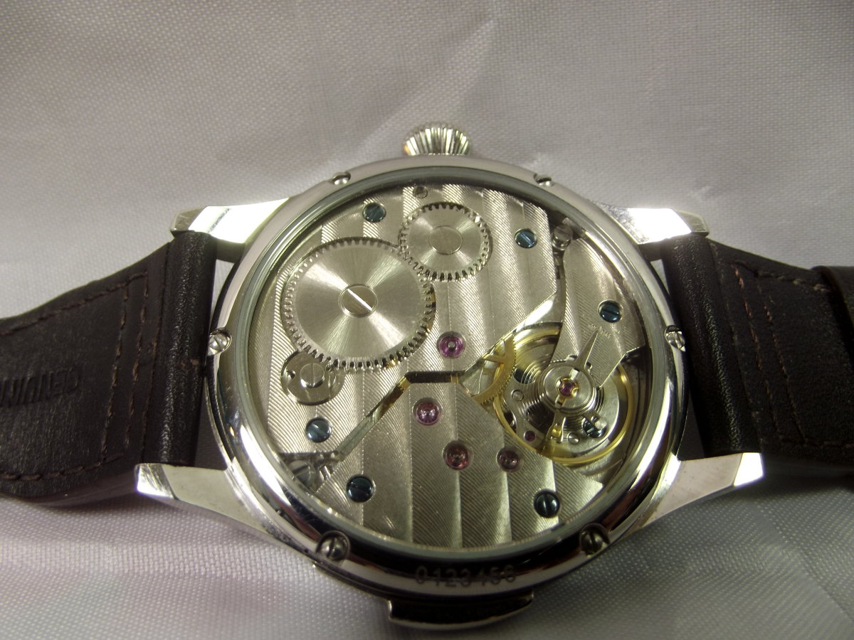 Unbranded Parnis Mechanical Watch with Seagull 6497 Movement. Note the lever (for adjusting accuracy) above the watch's balance wheel.