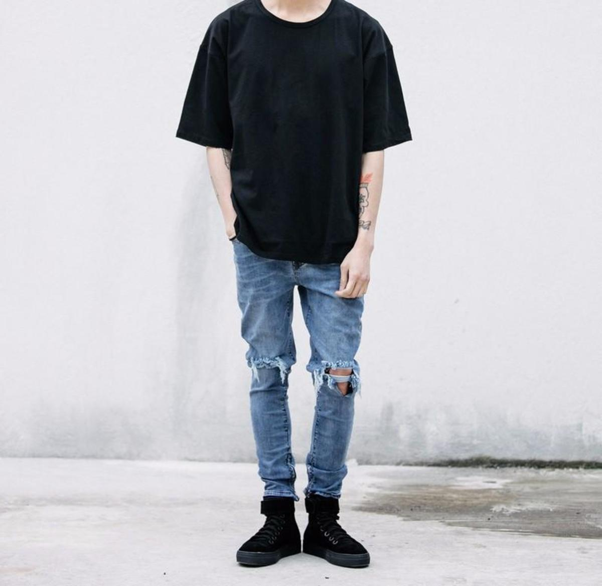 The distressed jeans and oversized shirts (like those released by Fear Of God and Yeezy) take a lot of inspiration from the skater and grunge cliques in the 90s. And the oversized aesthetic can even be traced back to hip hop culture in the 90s.