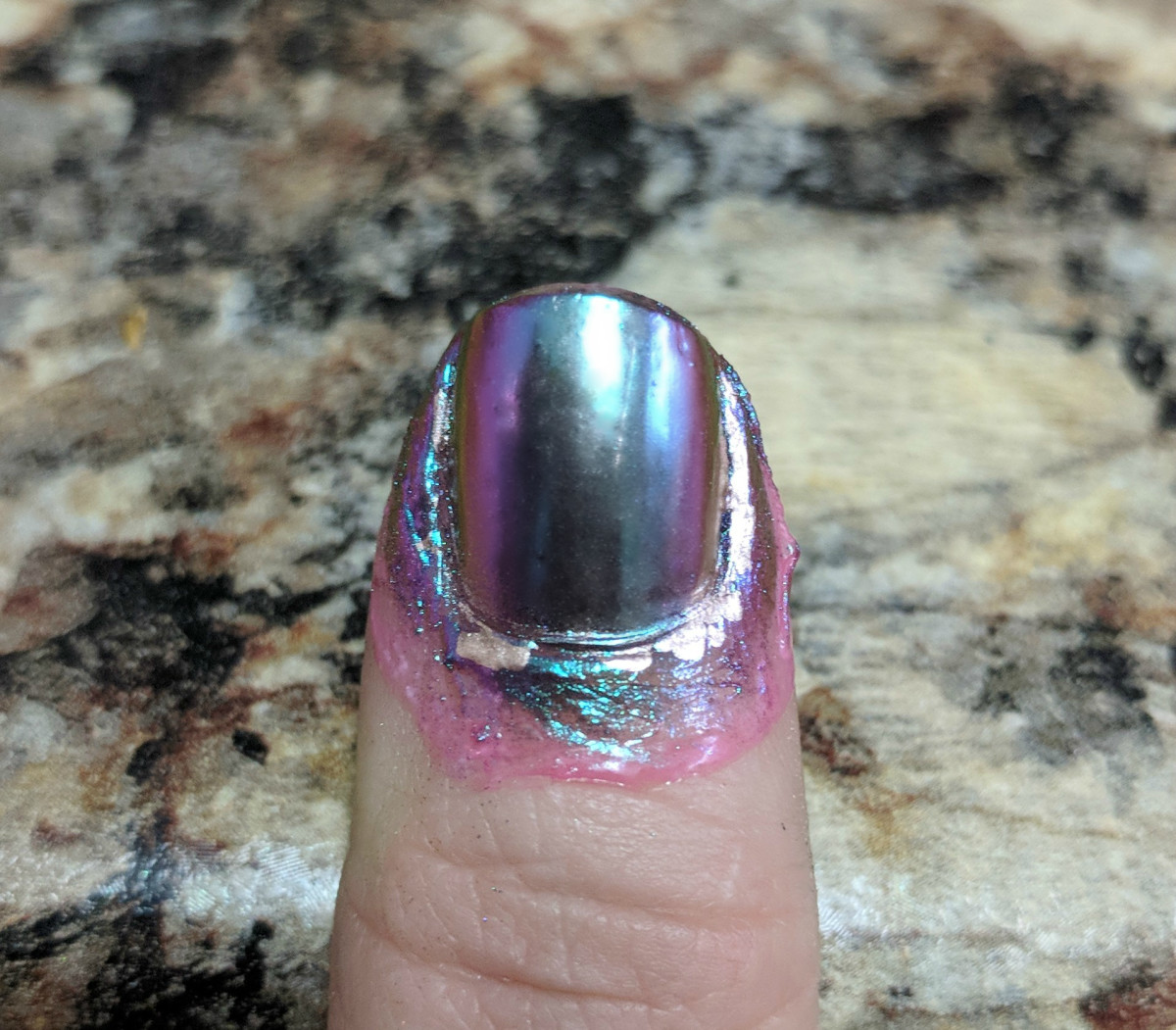 Apply a layer of ORLY and then gently dab and rub the powder in.