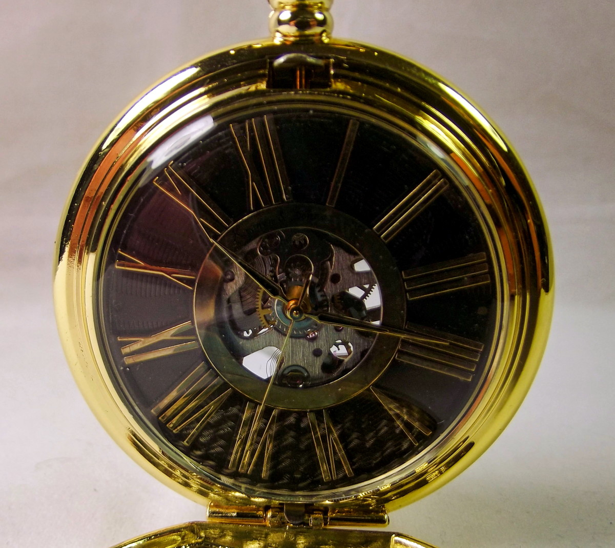 Kronen & Söhne KSP034 Mechanical Pocket Watch.  Note that neither the dial nor the hands are properly aligned.