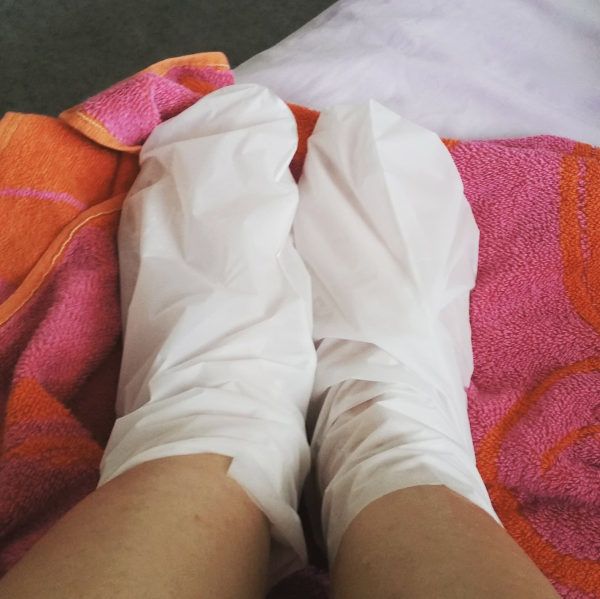 A picture of the Xpel Body care: XBC Moisturising Charcoal Foot Pack in use.