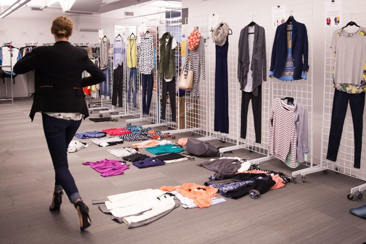 A personal stylist at the Stitch Fix office looks for great outfit combinations.