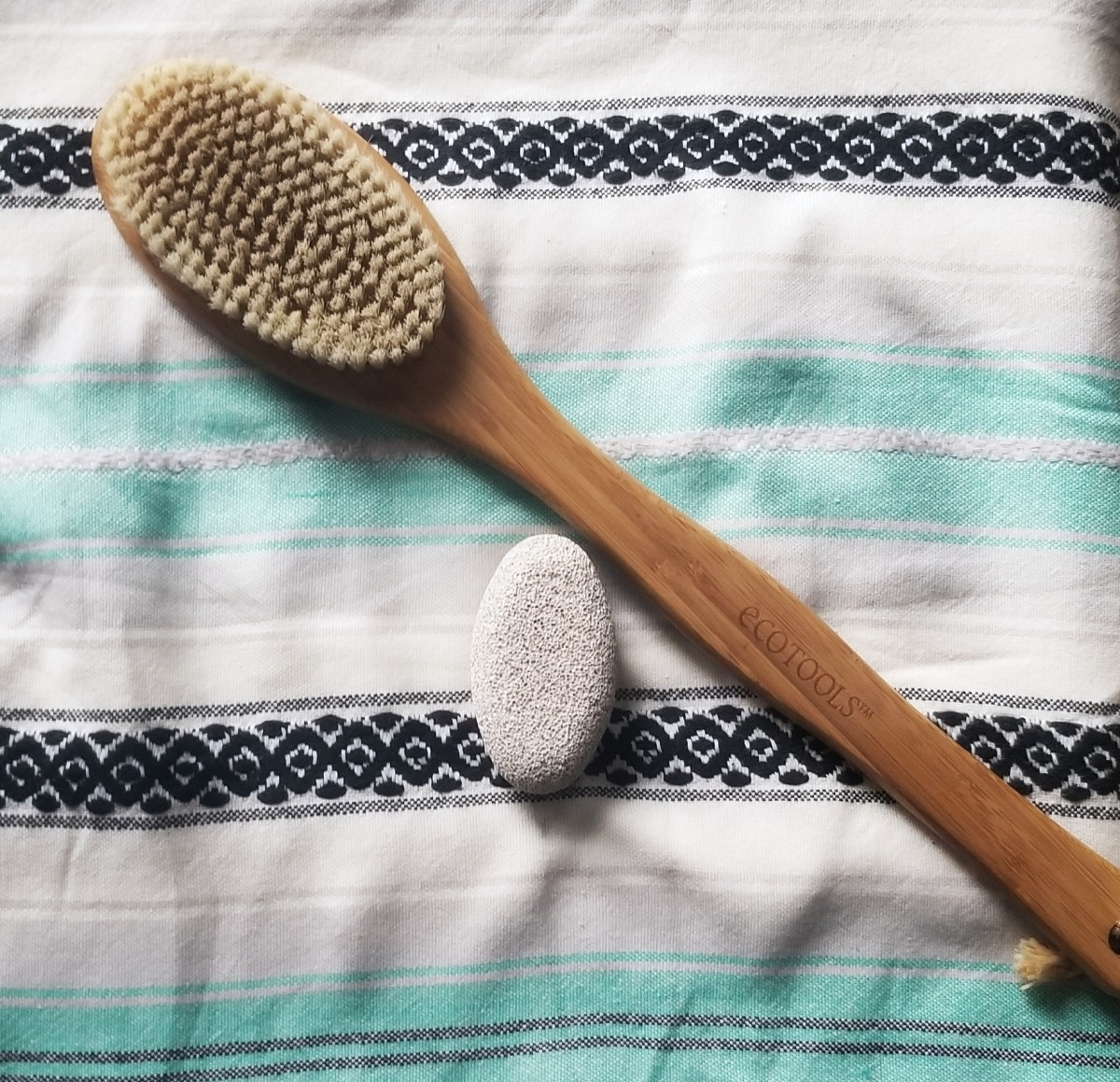 A dry brush and pumice stone are spring must-haves!