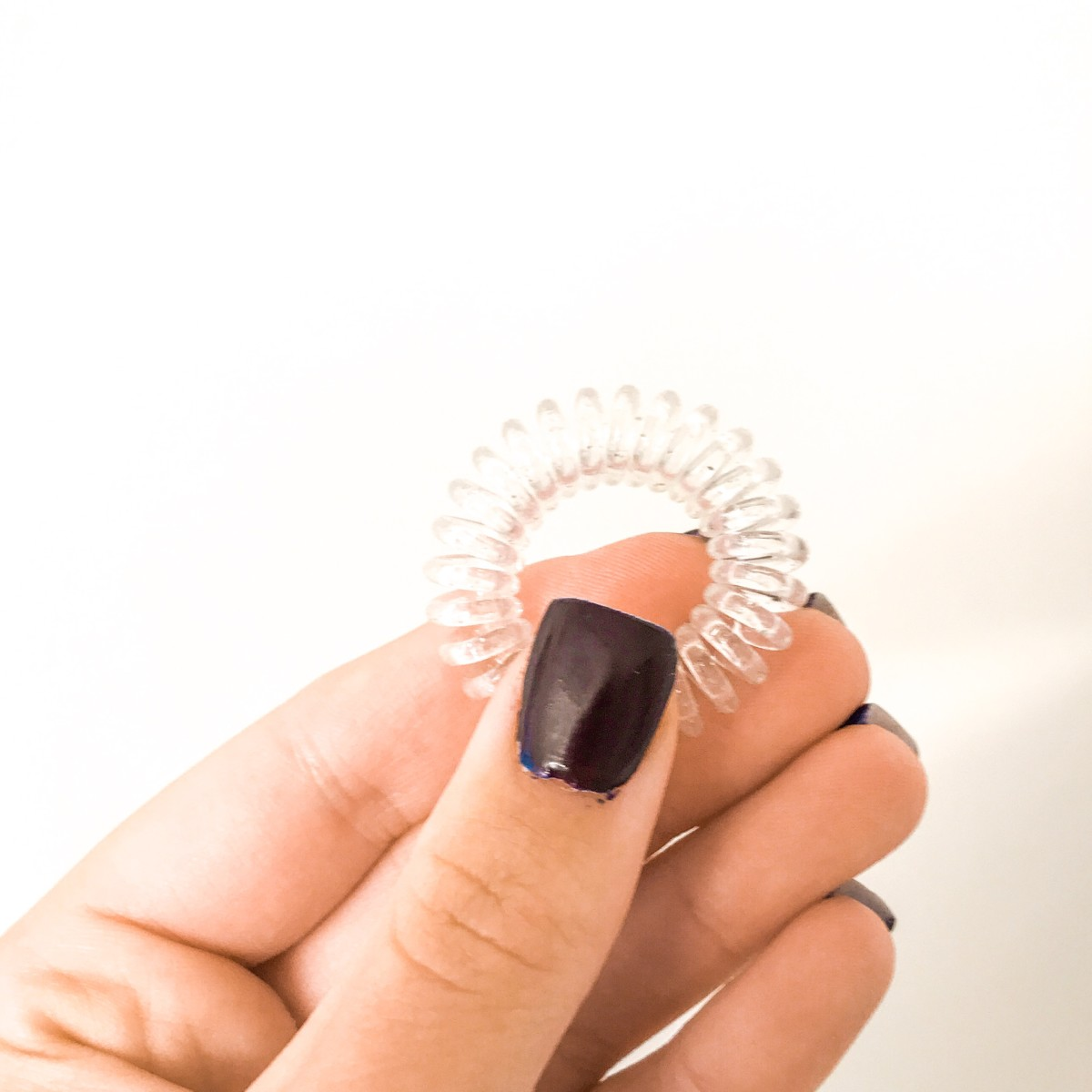 This is an Invisibobble hair tie. It will keep your hair from creasing.
