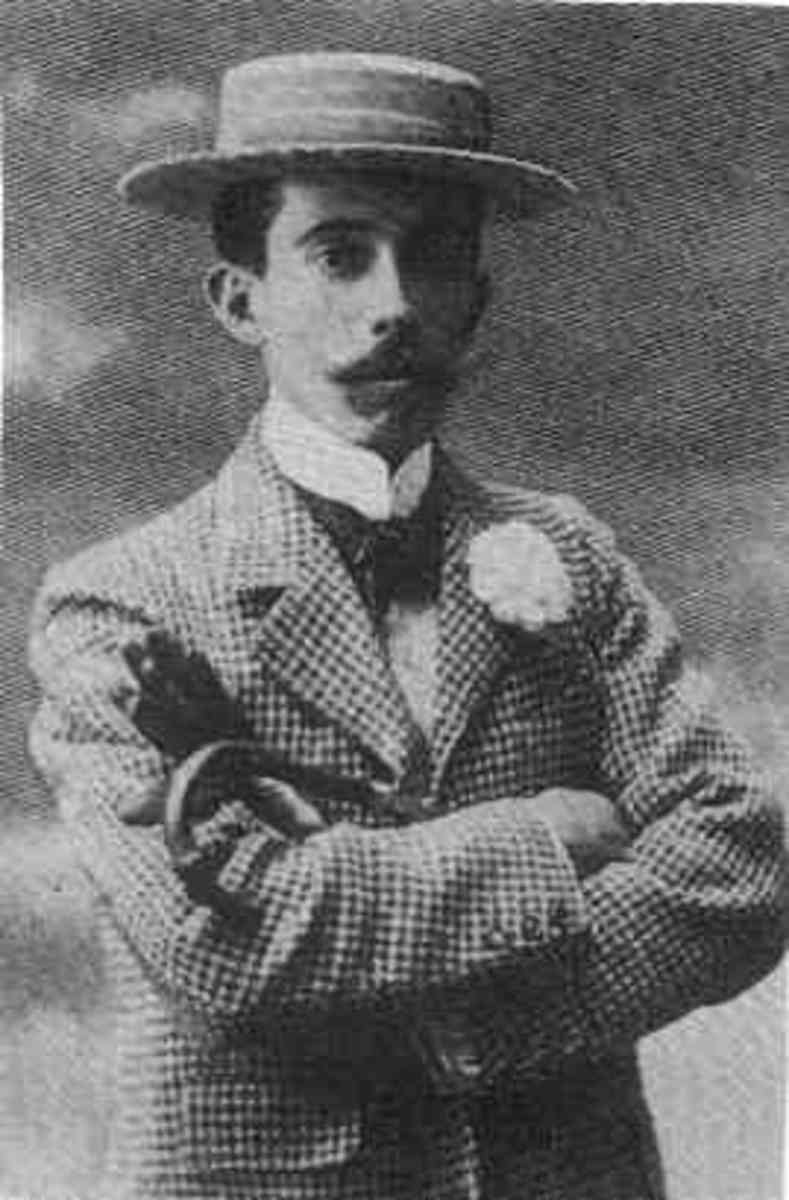 Man wearing a boater hat, a high collared shirt, and checked jacket