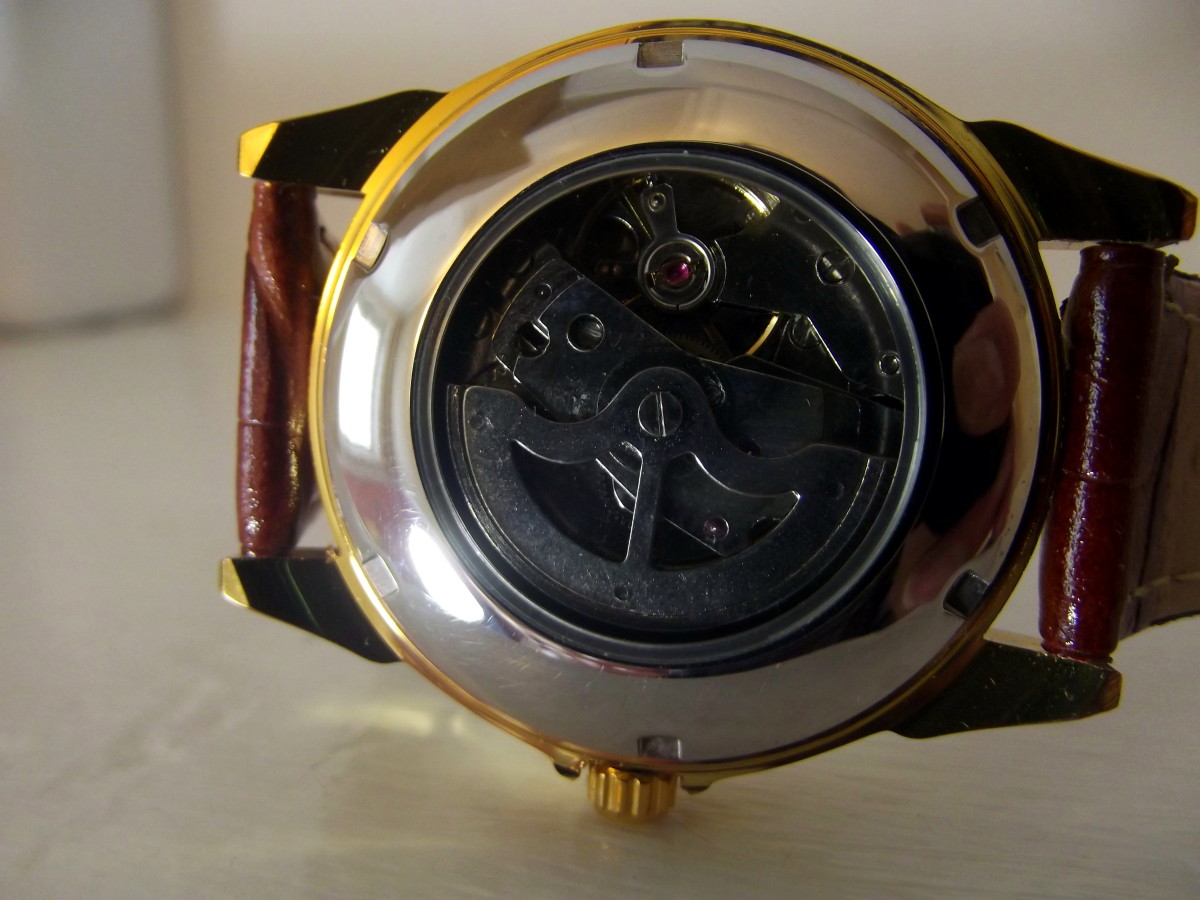 Automatic movement displayed through caseback of Sewor automatic wristwatch