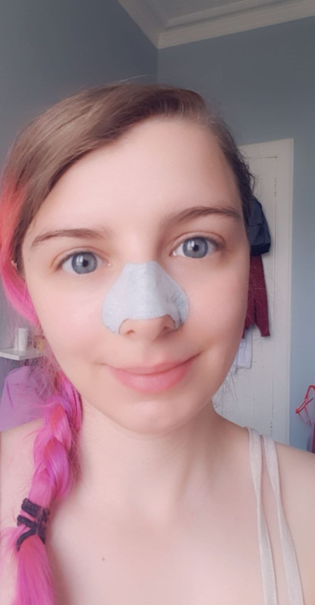The Beauty Formulas Purifying Charcoal Cleansing Nose Pore Strip in use on my face