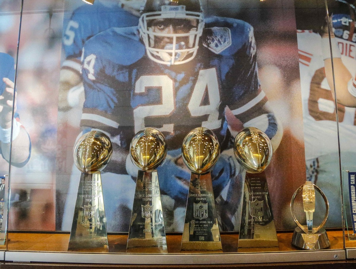 Four New York Giants Super Bowl trophies on display in the lobby of the Giants headquarters at Quest Diagnostics Training Center.