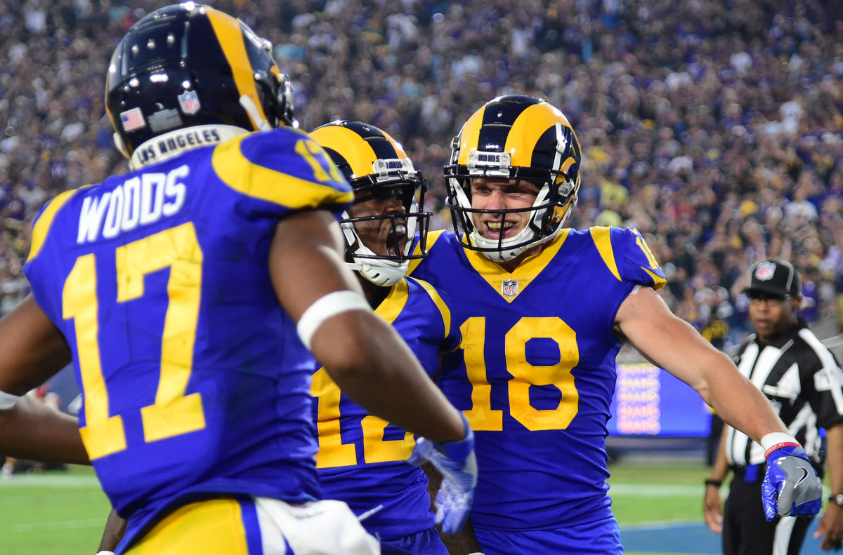 Los Angeles Rams wide receiver, Robert Woods (17), celebrates with fellow receivers, Cooper Kupp (18) and Brandin Cooks (12), after catching a touchdown pass in the second quarter against the Minnesota Vikings in 2018.