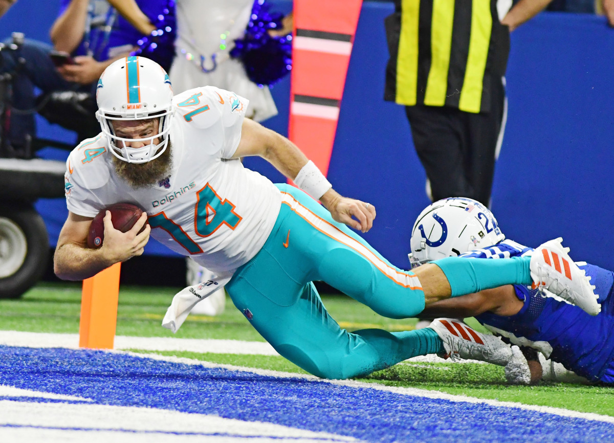 Miami Dolphins quarterback, Ryan Fitzpatrick, dives past the goal line for a  touchdown against the Indianapolis Colts. After starting a game in 2019, he became the 21st player to start for the Dolphins since Hall of Famer Dan Marino retired in 1999.