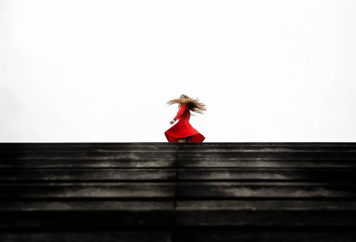 There's a Woman in Red: A Poem