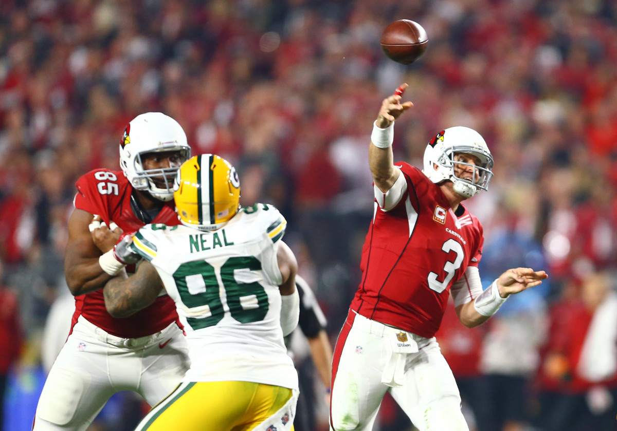 Former Arizona Cardinals quarterback, Carson Palmer, passes against the Green Bay Packers during a 2015 NFC Divisional round playoff game at University of Phoenix Stadium.