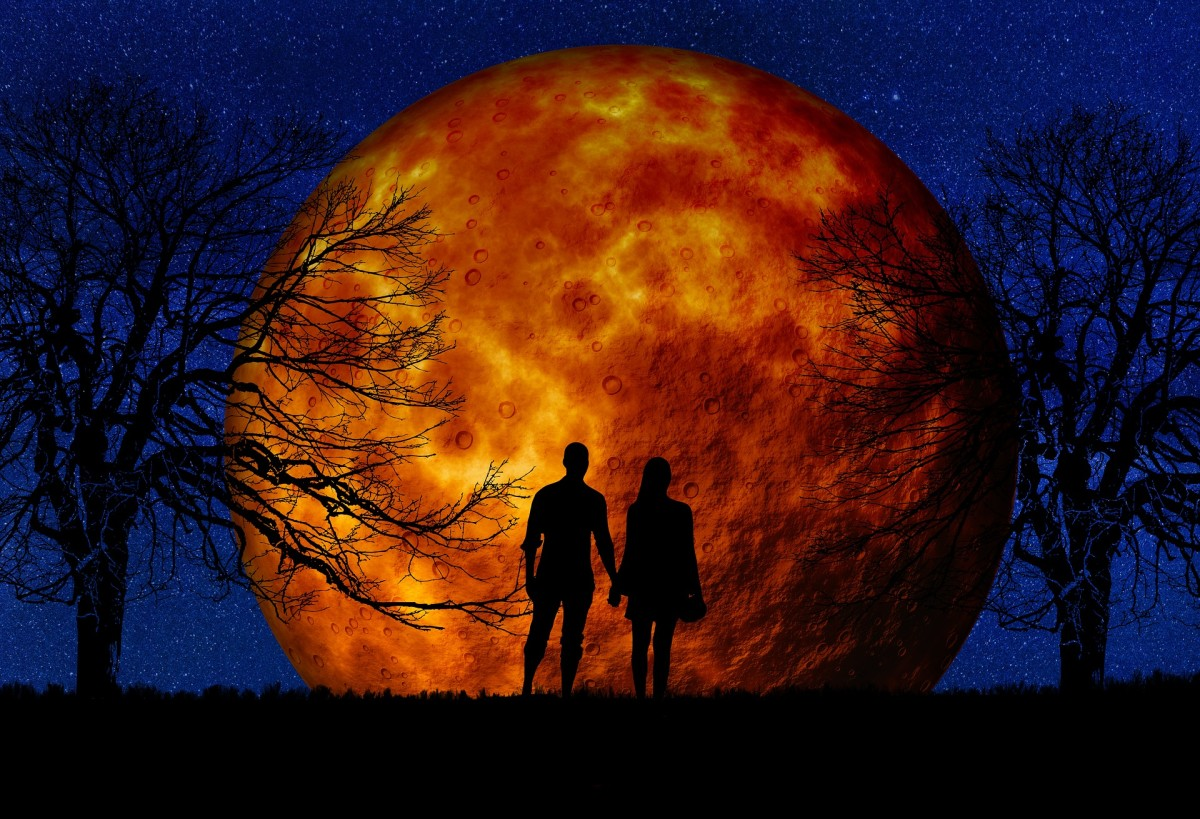 """The twins watch as the """"Devil's Moon"""" appears on the horizon"""