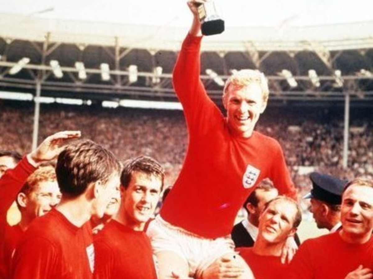 Geoff Hurst being lifted after England's defeat of West Germany at the 1966 World Cup.  Hurst remains the only player in Cup history to score a hat-trick in a final match.