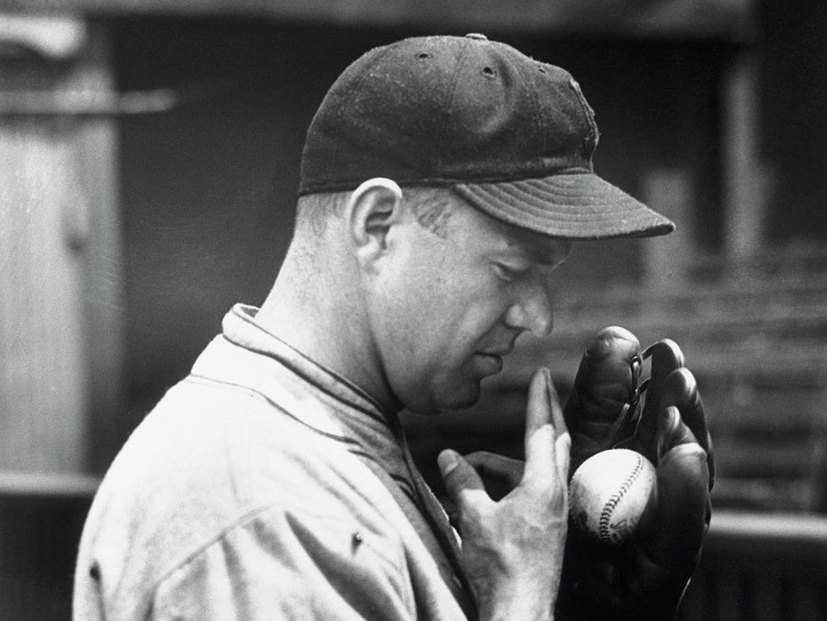 Burleigh Grimes wetting his fingers before launching a spitball pitch. Outlawed by MLB in 1920, the spitball was still allowed to be thrown by 17 pitchers who were exempt from the restriction. In 1934, Grimes was the last to hurl a legal spitball.
