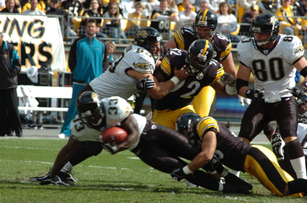 Steelers linebacker James Harrison (92) gets in on a tackle.
