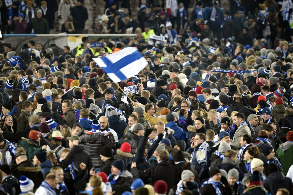 Finnish fans and players celebrate following the end of a Euro 2020 qualifying match in Helsinki, Finland, on Nov. 15, 2019. The 3-0 victory against Liechtenstein secured Finland's first-ever qualification for a major tournament.