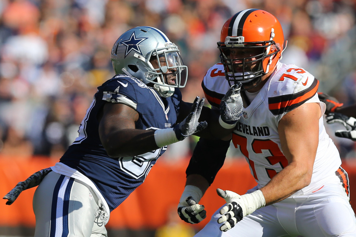 Cleveland Browns offensive tackle, Joe Thomas (73), holds off Dallas Cowboys defensive end, Benson Mayowa, during a 2016 game at FirstEnergy Stadium.