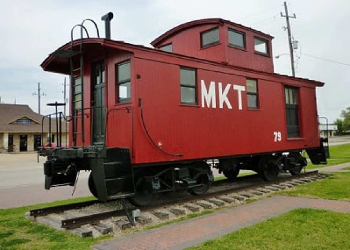 Bright red M-K-T caboose in Katy, Texas