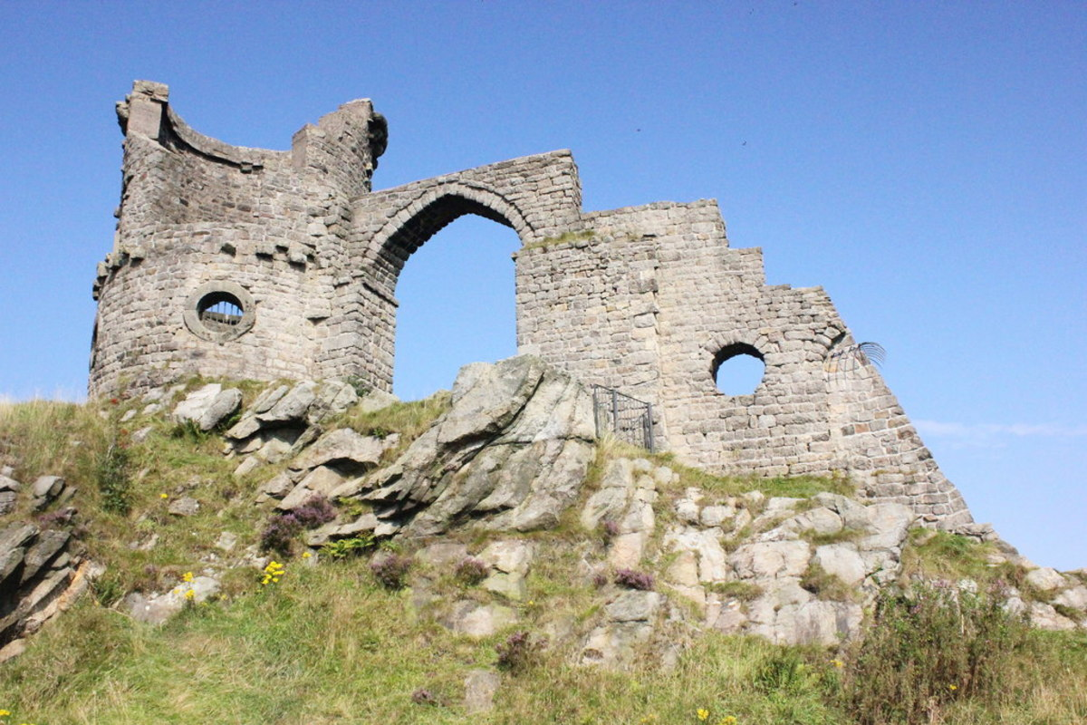 Mow Cop Castle in Cheshire, England is a folly that was built in 1754 to resemble a ruined medieval fort.