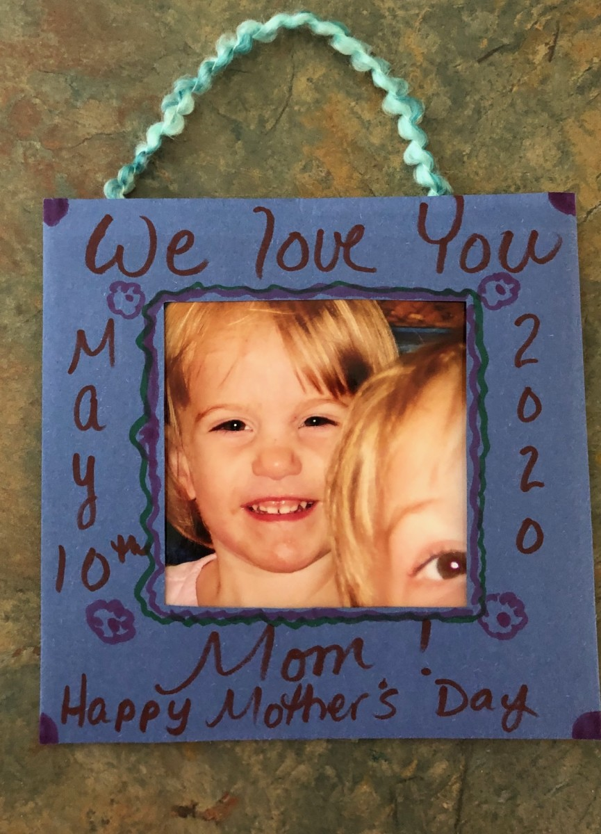 This Mother's Day, help the kids make a simple hanging picture frame for Mom!