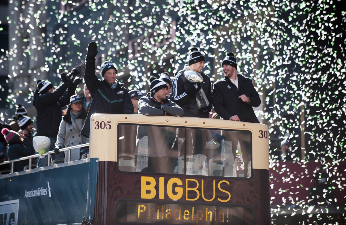 Confetti falls as (from right-left) Eagles QB Carson Wentz, Eagles back-up QB Nate Sudfeld, Super Bowl MVP Nick Foles, and Eagles owner Jeffrey Lurie ride a float during the Philadelphia Eagles Super Bowl LII victory parade, Feb. 8, 2018.