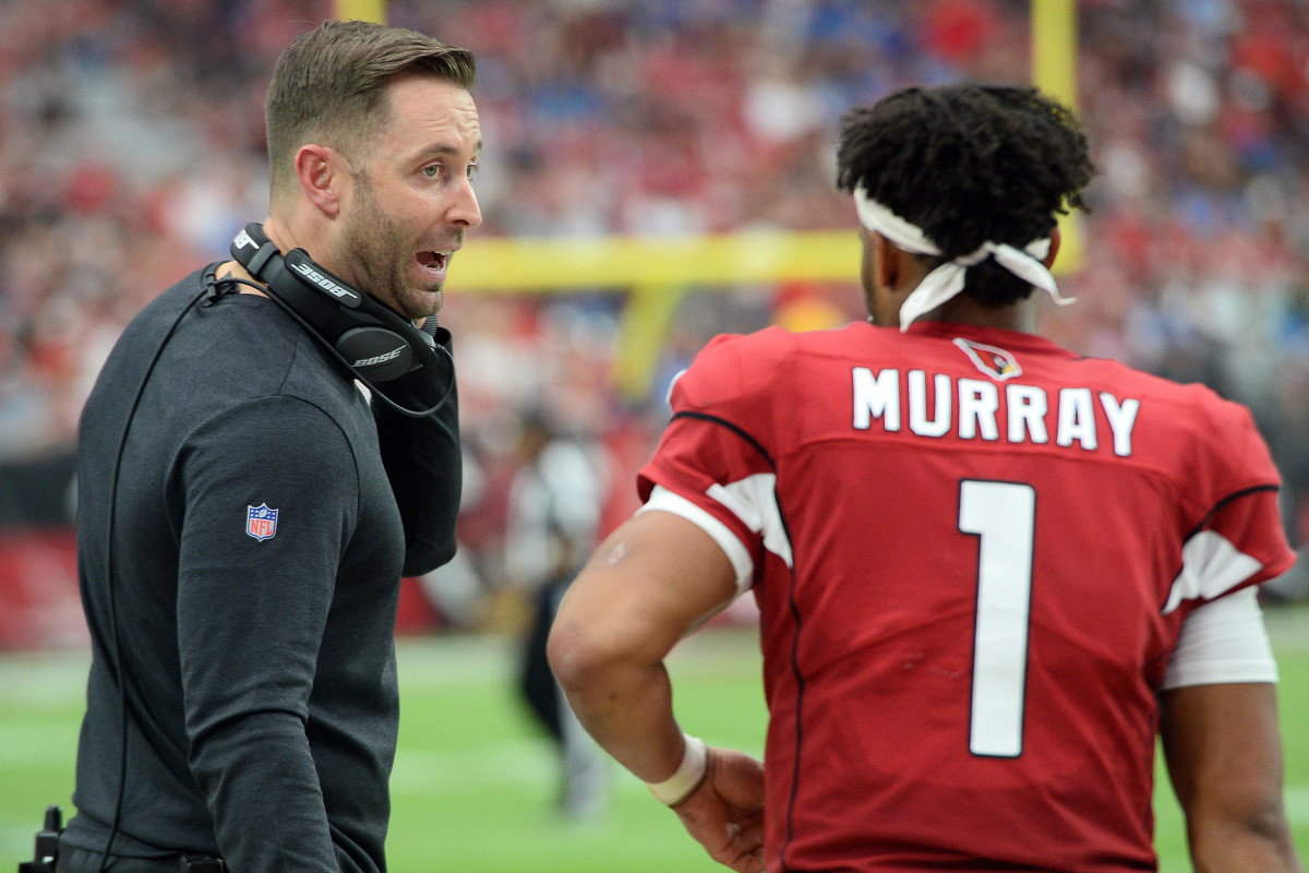 Arizona Cardinals head coach, Kliff Kingsbury, gives directions to rookie quarterback, Kyler Murray (1), in a 2019 game against the Detroit Lions at State Farm Stadium. A former quarterback, Kingsbury has been entrusted to develop Murray into a star,