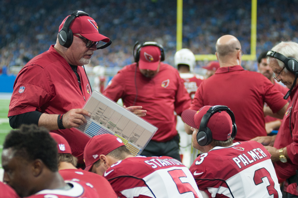 Former Arizona Cardinals head coach, Bruce Arians, talks to quarterback, Carson Palmer (3), during a 2017 game against the Detroit Lions at Ford Field.