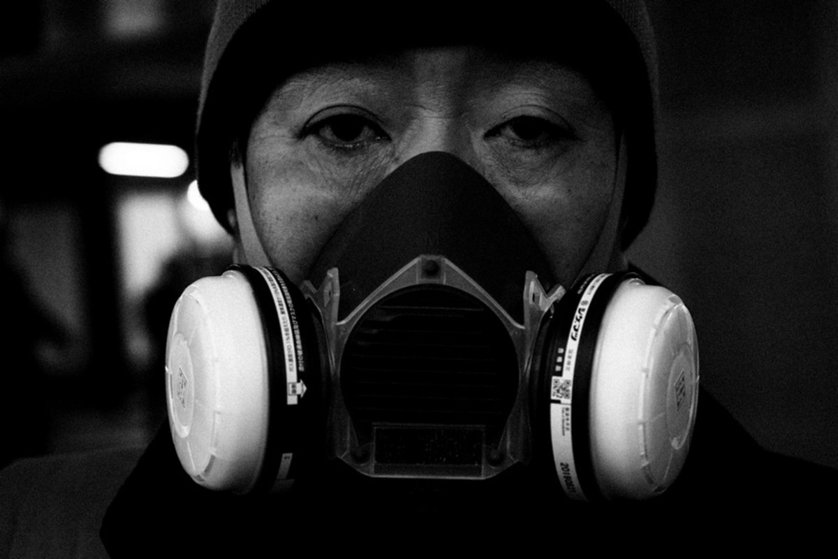 A masked man in Tokyo battles through the covid-19 outbreak that affected the whole world...