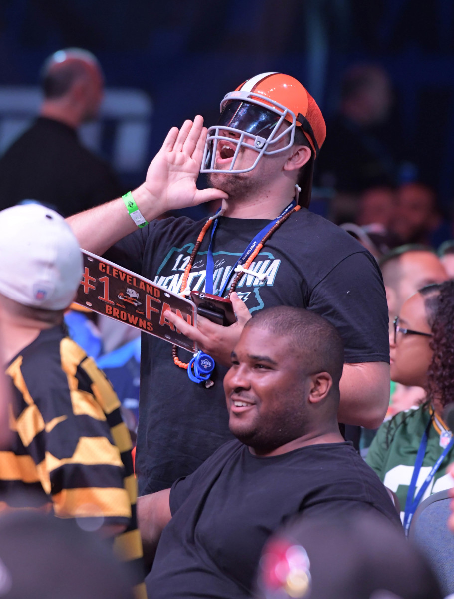 A Cleveland Browns fan shouts after one of the team's draft picks was announced during the 2017 NFL Draft in Philadelphia. It's yet to be determined how good the team's '17 draft class will be, but they do have an unfortunate history of poor drafts.