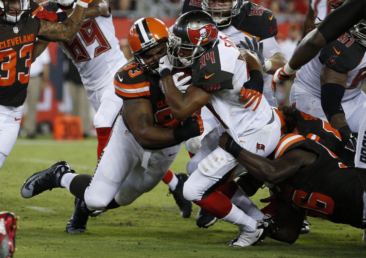 Former Cleveland Browns defensive end, Chris Hughes (93), makes a tackle against the Tampa Bay Buccaneers in the 2016 preseason. Hughes was one of few bright spots the Browns had among the players they selected in the 2012 NFL Draft.