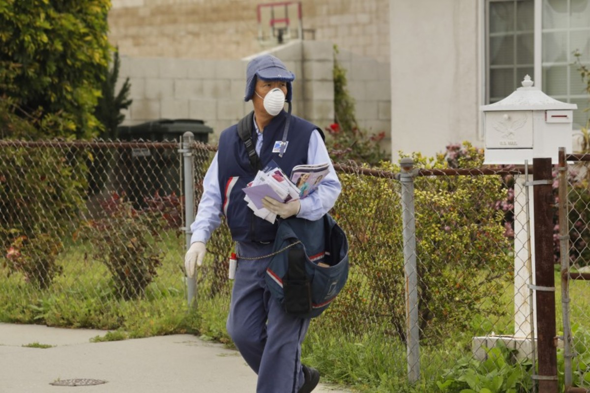 This SoCal letter carrier feverishly goes about his business, dodging dogs, and now, trying to avoid invisible, microscopic biters too.