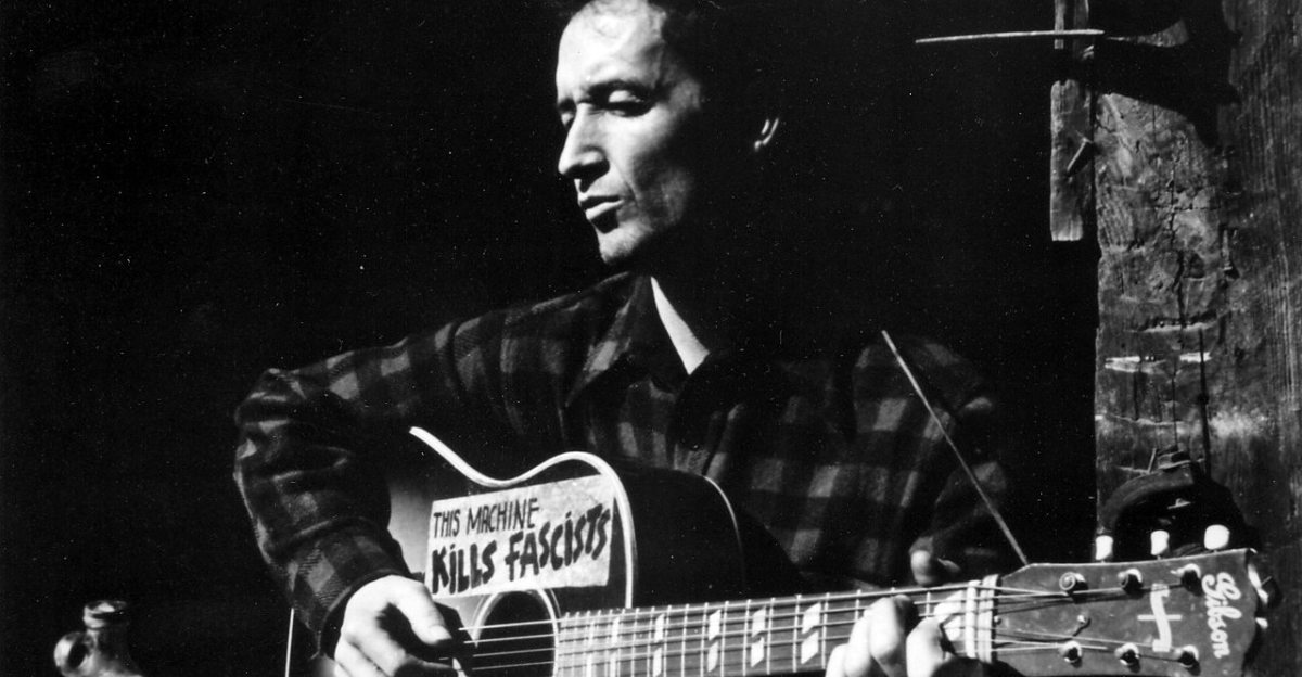 After years of hard traveling, Woody Guthrie became a household name with his lively collection of folk songs and ballads.