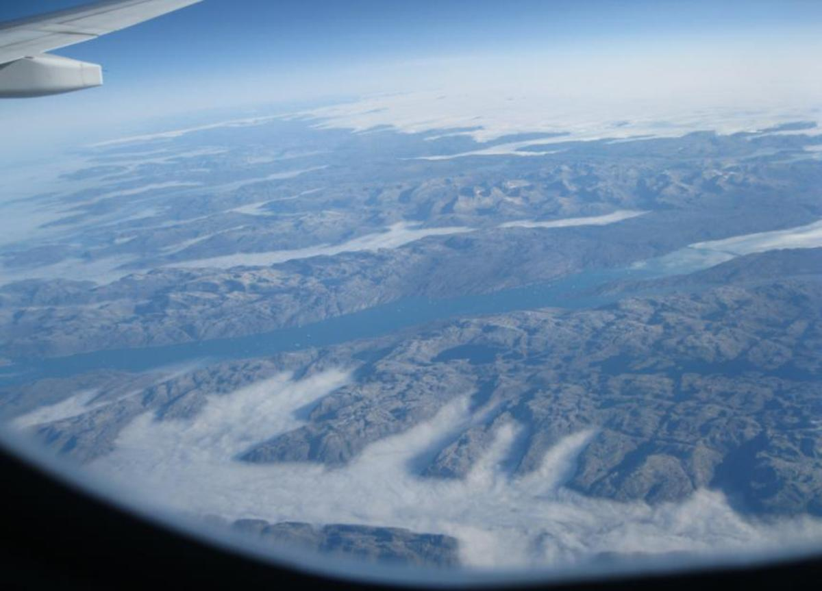 Mountains and fjords of SE tip of Greenland taken while flying 30,000 Feet above Greenland