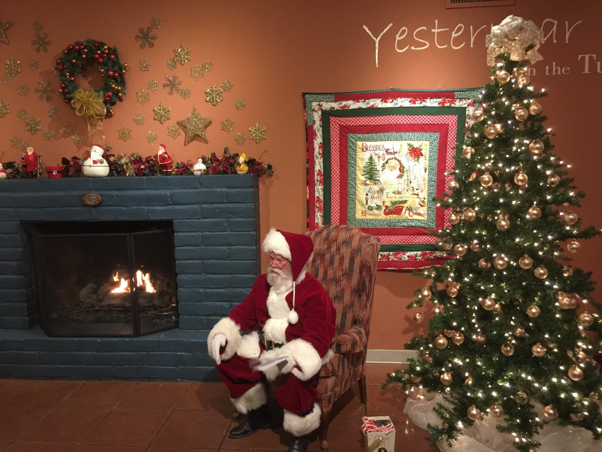 Santa Claus sitting by his fireplace waiting for little children to come.