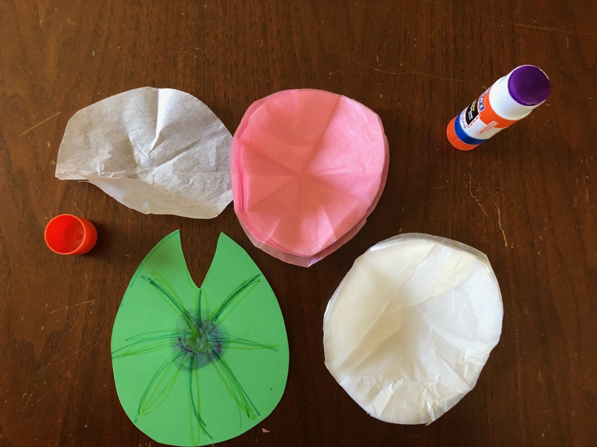 Cut circles of tissue paper a bit smaller than the lily pad.