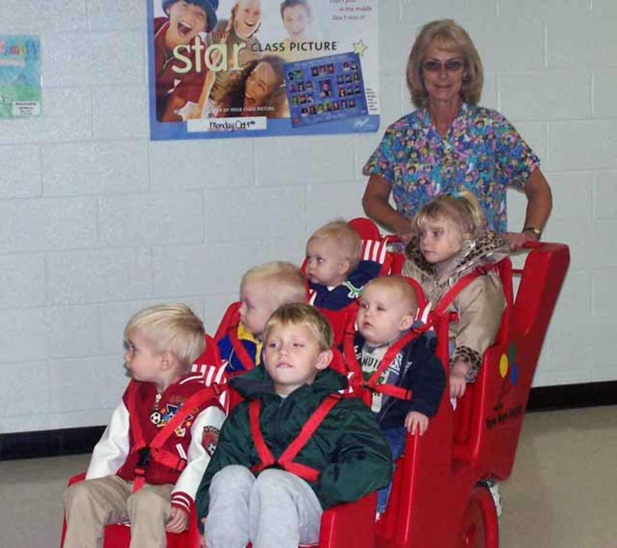 Children at a daycare go out in a modified stroller