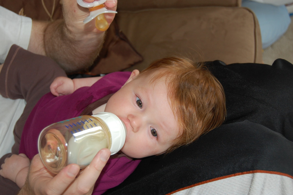 Pull the pacifier and insert the bottle.