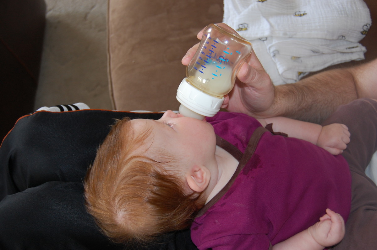 Keep the bottle tilted up, so she doesn't get air when she sucks.