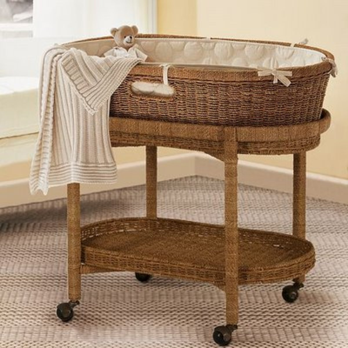 pottery barn kids bassinet frame with removed hood.  wheels lock.  plenty of storage below.