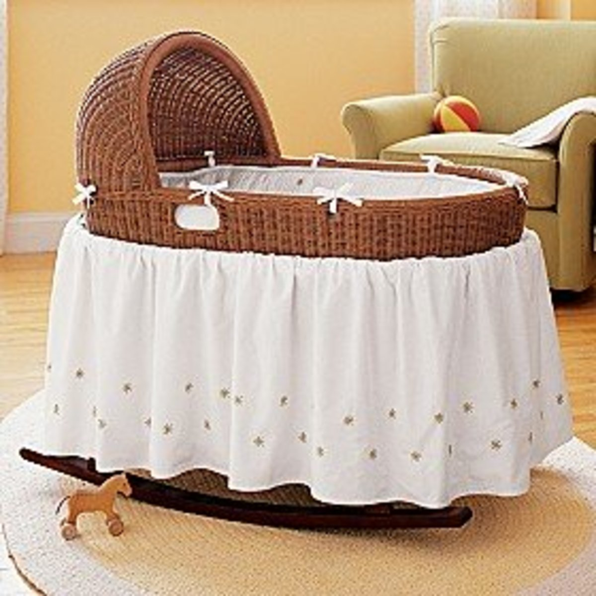 baby honey bassinet and bedding set.  also in esspresso and white.  rocks.  no storage. land of nod.