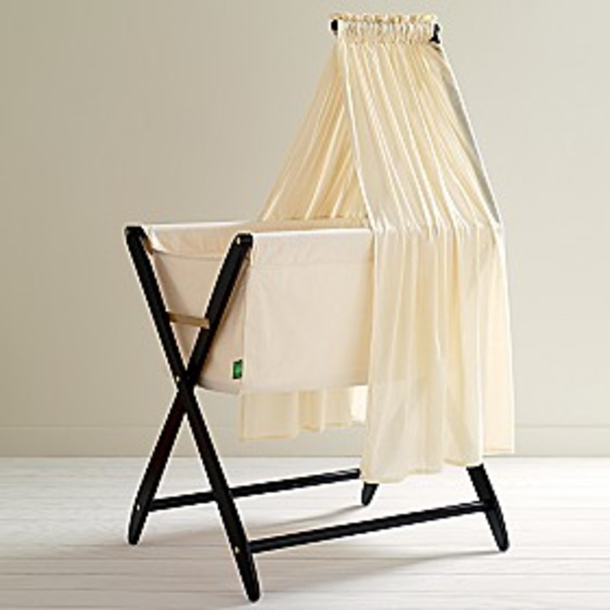 Cariboo Earth Folding Bassinet.  eco friendly.  folds.  land of nod.