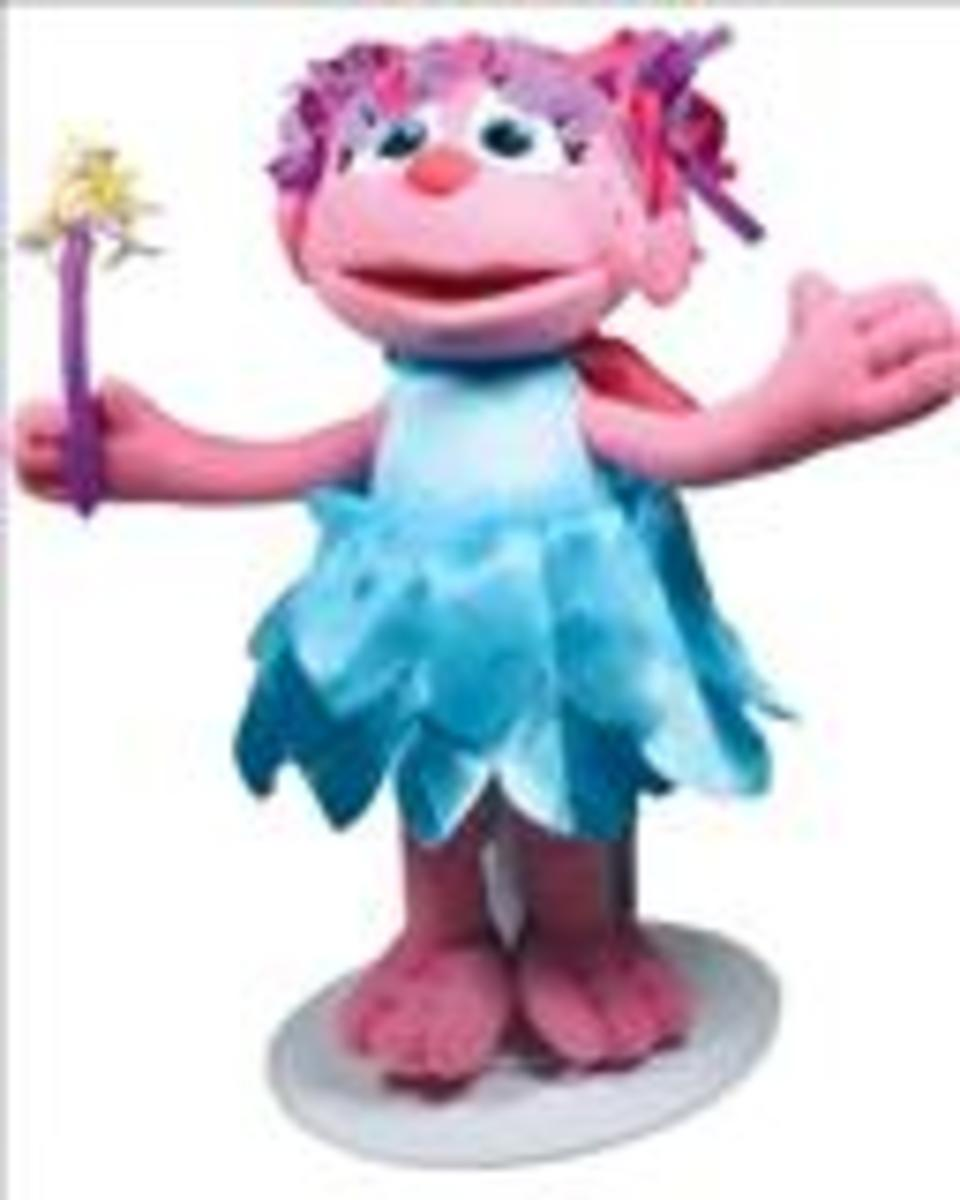 abby cadabby - connect a switch to the toy and push the button to activate her talking and singing